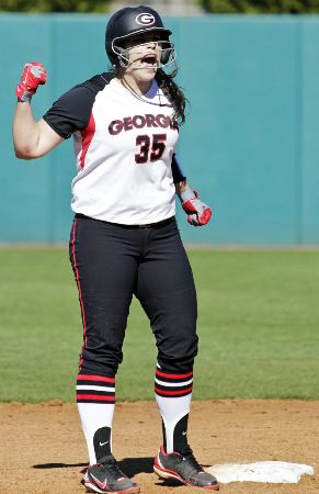 Rookie catcher, Katie Browne, is pumped up after hitting a double to the wall in an early 2013 game.