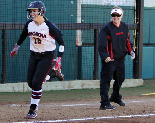 Geri Ann Glasco gets a smile out of Lu Harris-Champer after hitting her first home run as a Georgia Bulldog against Elon on 2/8/13.