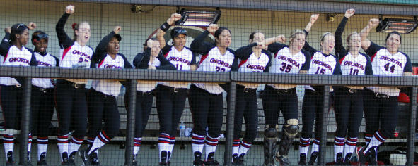 2013 Georgia Softball team cheering on the on-deck batter at the beginning of a game.