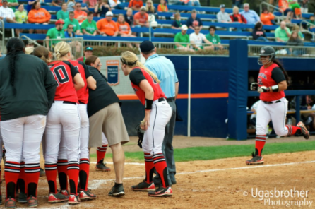 Tina Iosefa is mobbed at the plate after tying the Georgia rookie home run record with her 9th on the young season.
