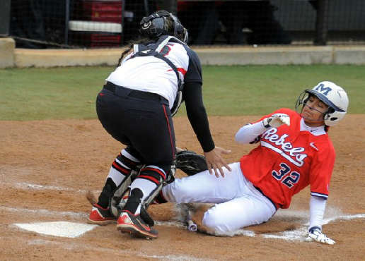 Katie Browne tags out Melina Preciado in a close play at the plate on Friday evening.