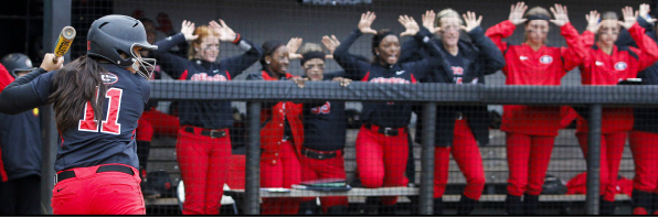 "Georgia's dugout does the ""Moose"" cheer for Georgia rookie OF/U, Kaylee Puailoa, in a game against Ole Miss."