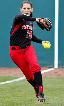 Senior Christine Olney relays a ball to the infield in a game against Ole Miss.