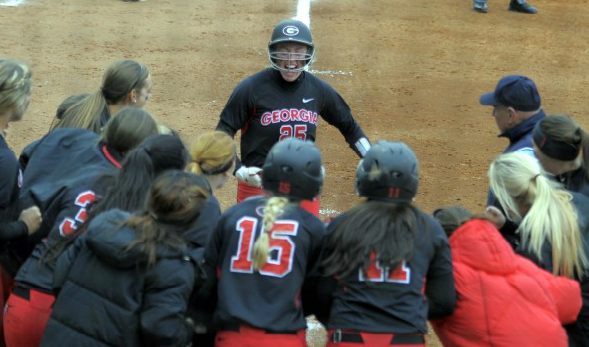Anna Swafford is mobbed at home plate after hitting her first home run of the season.
