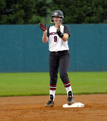 Paige Wilson cheering her team on in the rain after doubling in Niaja Griffin in the first inning against Texas A&M on Friday.