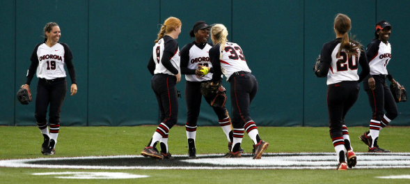 Niaja Giriffin is congratulated by teammates in Friday's contest after making a web gem catch against the wall in center field.