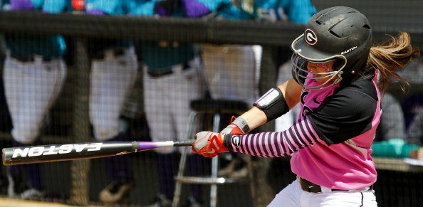 Senior Christine Olney connects for a base hit to left field on Sunday against LSU.